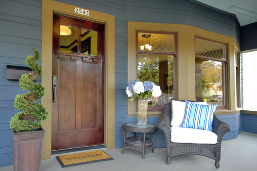 Large, pleasant front porch with seating for many to have a cup of coffee or glass of wine!