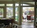 Dining Room and Covered Patio: This photo was taken from the kitchen and shows the French doors and windows looking out onto the patio and pool. 