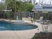 Pool: Another view of the pool, spa, and rest of the back yard. We have several young citrus trees, two cherry trees, two nectarines, and a peach tree. There are also two raised garden beds for vegetables. 