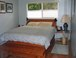 Master Bedroom: The master bedroom has a small bathroom with shower, walk-in closet, and TV with DVD player.  