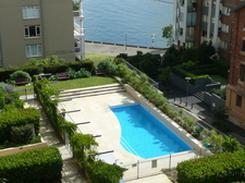 view from balcony to pool across to harbour