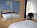 Double Bedroom 1: Windows to both the Ashton Canal (shown) and the Canal Basin.