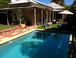 View from the back fence - swimming  pool and outdoor entertaining area