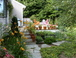 Outdoor beauty & comfort: Stone patios, decks, flower gardens, kitchen herb garden, hot tub and outdoor shower all with a mountain view.