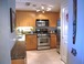 Kitchen: Our full-size kitchen, with granite countertops and tile floor. The washer/dryer is behind the door on the right.