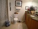 Master bathroom: Full-size tub, with shower ... granite countertop and tile floor. Enormous mirror is the length of the room. Spacious!