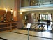 Front lobby: The hotel-like lobby of our building, with 24/7 front desk staff. The staff are all very helpful and nice. The lobby even has an ATM! The Business Center, with its exchange library, is just past the round table, on the left.
