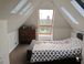 our double bedroom in the loft has a large window that opens out to form a mini balcony. You can see stars through the rooflights at night