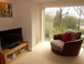 The large comfy chair swivels round so you can either watch the TV or even better look at the lovely views
