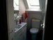 downstairs bathroom: Bathroom with Bathub/shower accross the hall from the downstairs bathrooms.