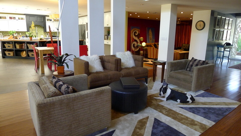 Living Room 2: Open floor plan with many seating areas.  Note our lovable dog, Pippin, on the Union Jack flag!