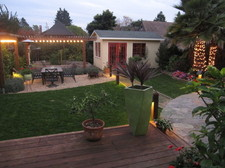back yard, looking toward outdoor seating area, fire pit and artist studio