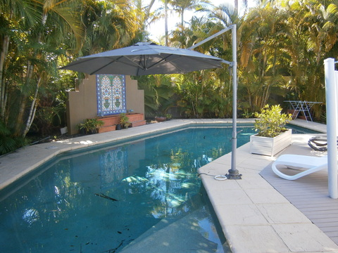 Outdoor Pool and Deck: Relax in the salt water pool with deck chairs
