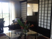 Shoji Screen: Sliding shoji screen divides living room from bedroom.