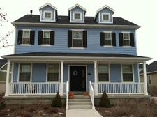 The front of our lovely light blue house