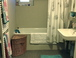 Hall Bathroom: Not visibile are the washer and dryer. There is also a second half bath (toilette and sink) near the parent's bedroom.