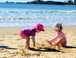 Our two girls playing at Mooloolaba beach in winter time (August)
