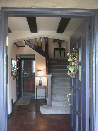 foyer: Gracious entry. This hallway leads to dining room on the right, living room and french doors to office on left, ahead to gourmet kitchen, breakfast room, and family room (fourth bedroom).