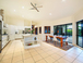 Sitting room looking back at the dining and Kitchen (open plan Queensland l