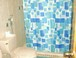 Ensuite bathroom in the 3rd (twin) bedroom : Vibrant colors coincide with the ocean theme