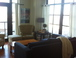 Living room: Huge windows for great light and views, but very quiet.  The sectional pulls out into a comfortable sleep sofa.
