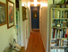 Hallway leading to the office.: We have lots of original art from all over the world. The house is very cozy with great wood floors.