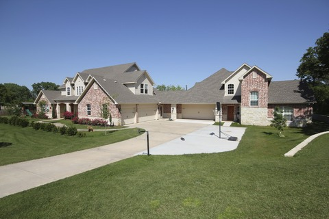 Main Exterior: Enjoy a spacious 5500 square ft Texas home with a private 1.5 acre lot.